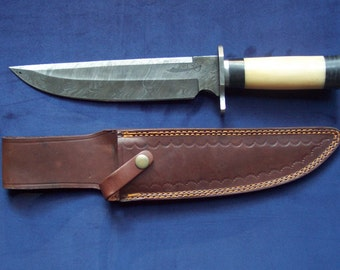 Custom handmade Blaze pattern Damascus steel Bowie knife with a custom hand tooled heavy duty leather sheath