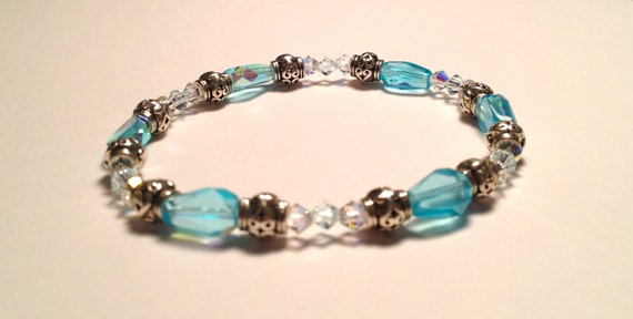 SJC10006 - Bracelet with clear light turquoise shimmering glass beads, silver plated spacer and Swarovski clear crystals