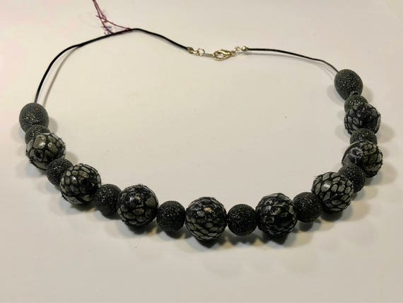 SJC10158 - Handmade necklace with fabric sparkling and plaided black beads with black leather cord and silver plated endings and clasp