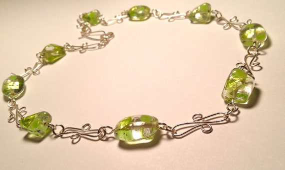 SJC10233 - Necklace with silver plated wire work and shimmering and solid green flakes clear beads