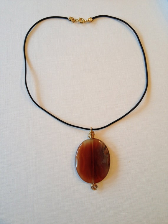 SJC10232 - Necklace with orange brown agate oval gemstone with black leather thread