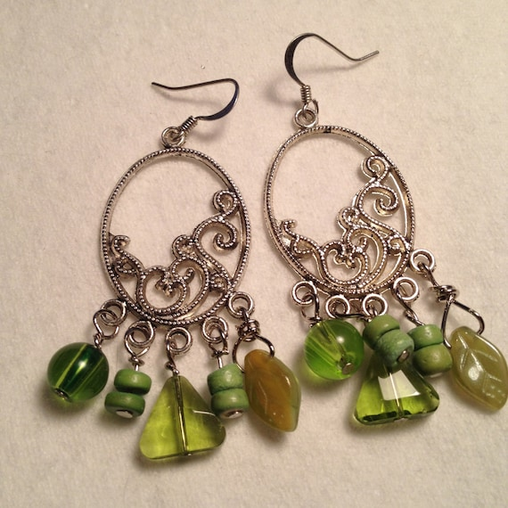 SJC10251 - Silver plated earrings with light/lime green glass beads of various size and shape and ceramic donut beads