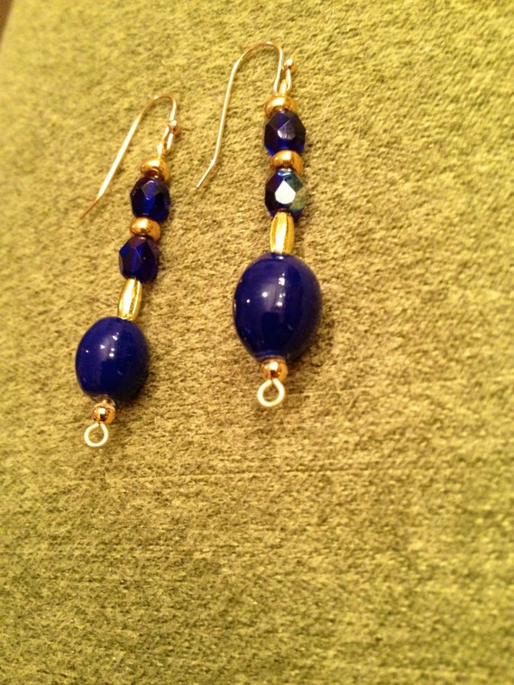 SJC10047 - Earrings with blue ceramics oblong beads and marine blue Swarovski multifaceted crystals, golden seed and oblong beads