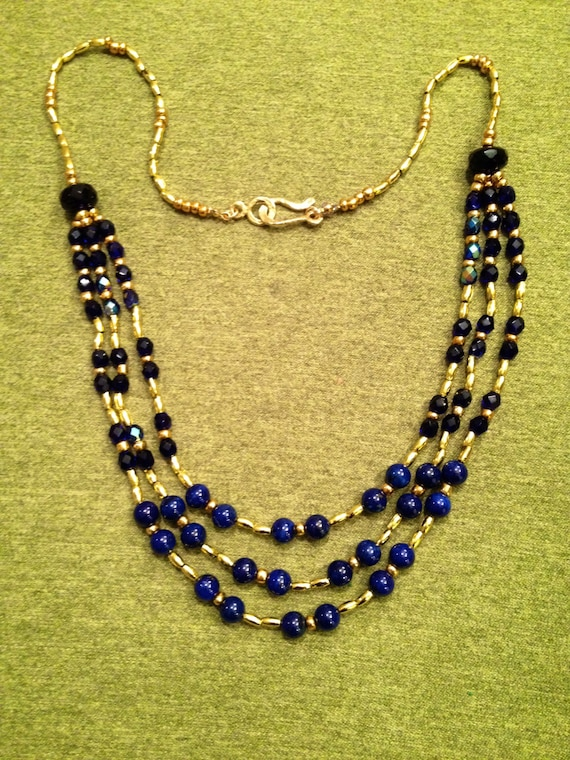 SJC10267 - Three-strings necklace with blue lapis lazuli round beads, golden seed and oblong beads and marine blue Swarovski crystals