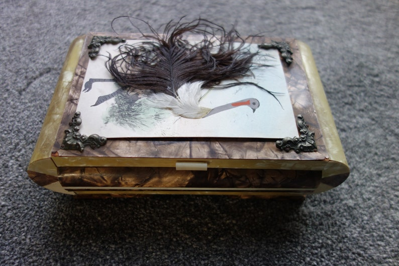 art deco musical jewellery box celluloid with postcard feature with real feather