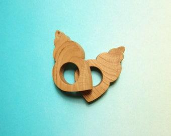 Set of two seashell napkin holders in chestnut wood