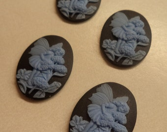 25mm x 18mm oval vertical fairy girl smelling flowers blue on black 4 pc lot cameos cabochons