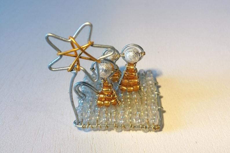 Bead and wire Nativity scene sculpture.