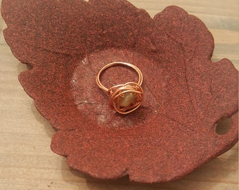 Copper nest ring with green stone
