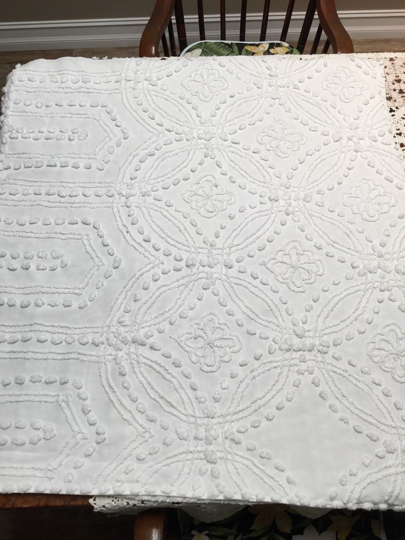 Large piece of vintage chenille bedspread with eight flowers in white