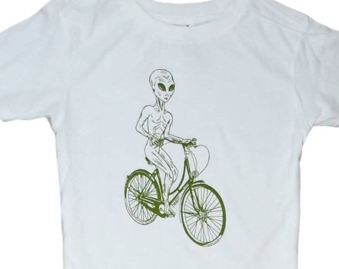 Toddler T Shirts - Boy or Girl Clothes - Olive Green Alien on a Bike - White Unisex T Shirt - Screen Printed TShirts for Kids - Kids Clothes