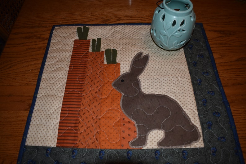 Primitive Bunny and Carrots on this Wall Warmer measuring about 18 x 18