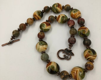 Brown and cream swirled painted beaded necklace with copper accents