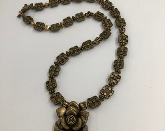 Square bronze beads lead to a bronze rose - different and subtle