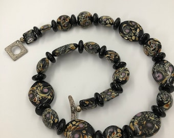 Ceramic beaded necklace with swirls of wonderful colors.