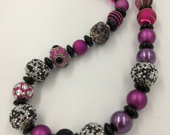 Bring on the bling! Pink sparkly necklace will bring on the fun!