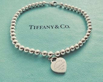 6d7405f17 Authentic Please Return to Tiffany New York Heart Tag Sterlng Silver Small  Bead Ball Bracelet, 7""