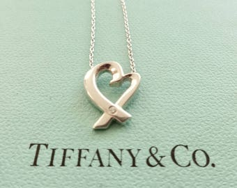 Authentic Tiffany & Co. Paloma Picasso Loving Heart with a Diamond Sterling Silver Pendant Necklace