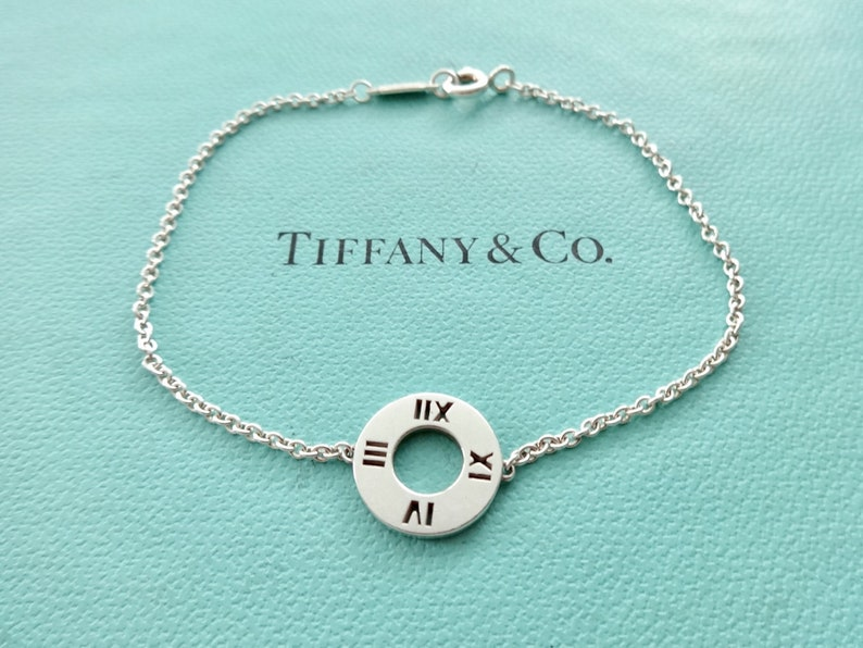 0442962d79f70 Tiffany & Co Atlas Pierced Roman Numerals Round Circle Sterling Silver  Pendant Bracelet