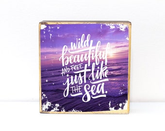 Wild beautiful and free just like the sea, hand lettered quote over photo of a San Diego, California beach at sunset, image transfer on wood