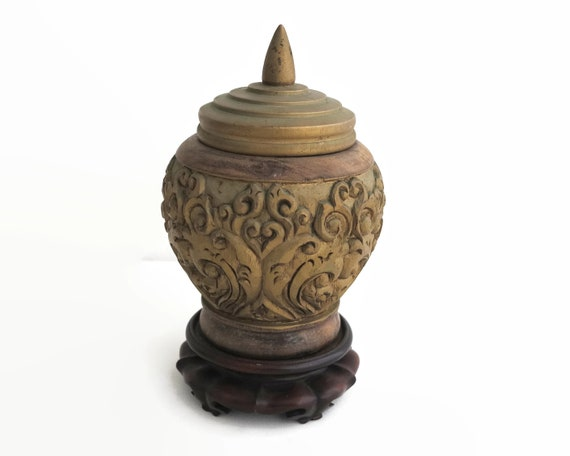 Vintage Chinese carved funerary urn with lid on decorative stand, carved gilded wood, stylized pattern, circa mid 20th century