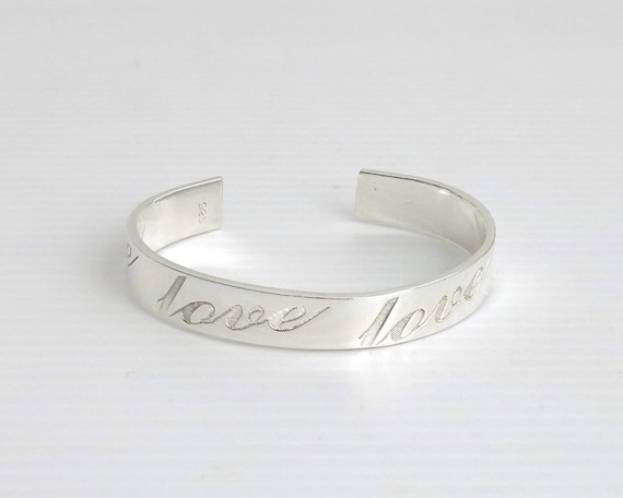 "Sterling silver cuff bracelet with ""love"" engraved 4 times in large script, open back, 24 grams"