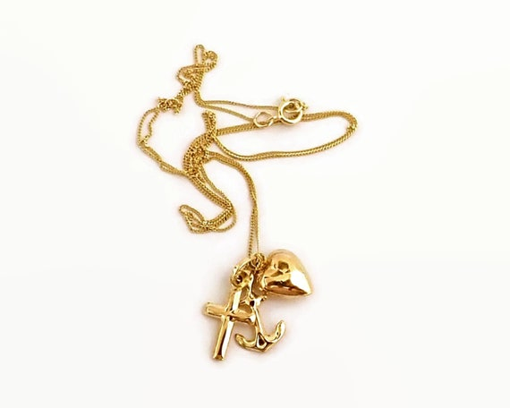 9 carat gold faith hope and charity pendant on fine 9 carat gold chain, stamped 375, 1.15 grams