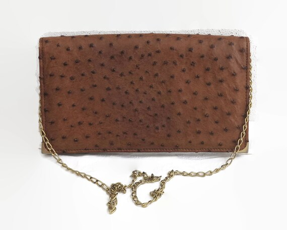 Vintage brown ostrich leather shoulder bag or clutch with gold link handle, soft suede lining, made in Italy, circa 1980s