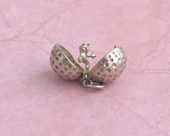 Sterling silver charm of ball with hidden ghost figure, 4.5 grams