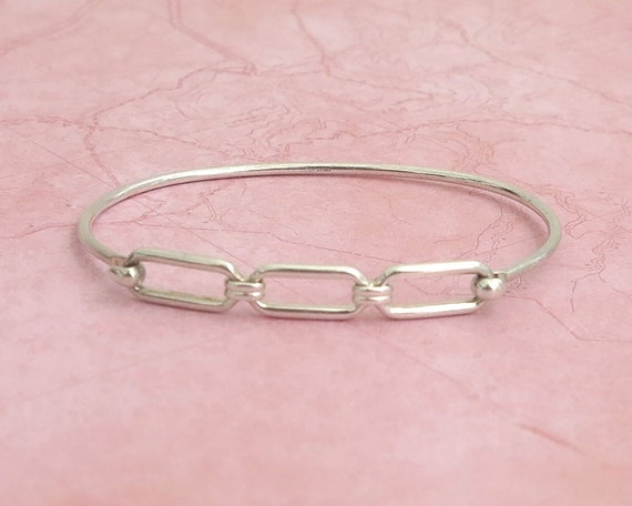 Sterling silver cuff bracelet with 3 open links and hook closure, stamped Sterling, oval shaped,