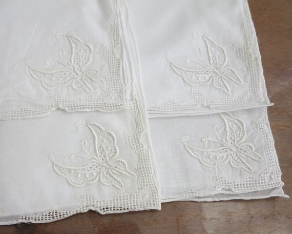 4 large vintage white linen embroidered napkins with butterflies and drawn thread work, mid 20th century, 16 inches / 41cm square