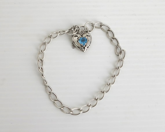 Vintage sterling silver curb link bracelet with filigree heart padlock closure with blue heart stone, safety chain, 9.5 grams, 8 ins / 20cm