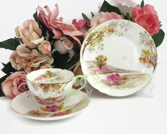 Shelley Old Ireland trio, cup, saucer, and plate, hand painted scene of Irish countryside with pink and gilt trim, 13657, 1945 - 1966