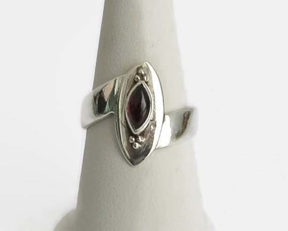 Sterling silver and garnet ring, oblong cabochon garnet in elevated bezel setting, asymmetrical band, size Q / 8, 4.5 grams