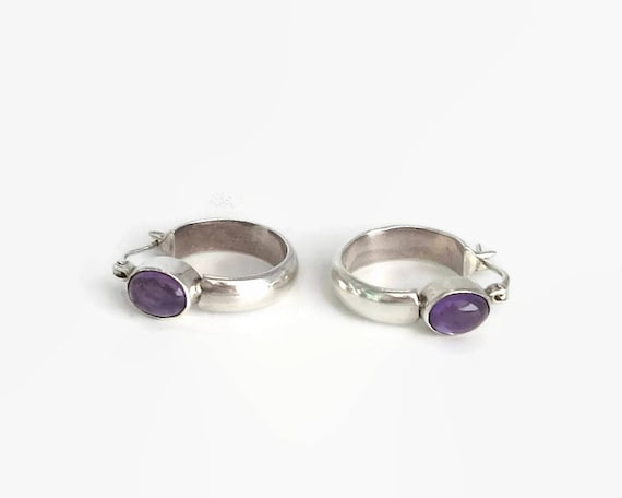 Sterling silver amethyst hoop earrings, circular hoops with amethyst cabochon in bezel setting, hinged latch back closures, 11 grams