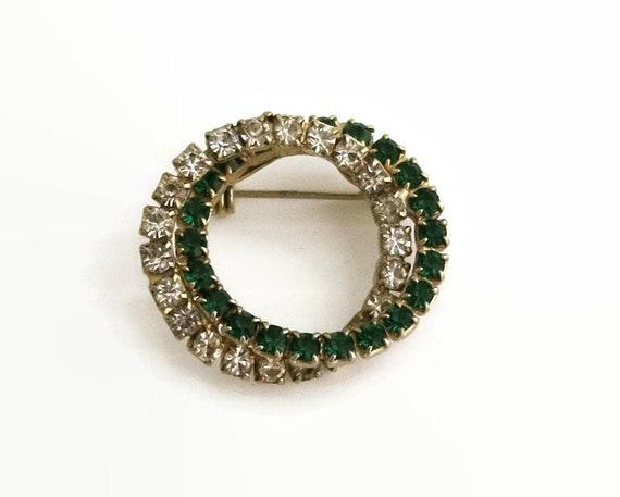 Vintage rhinestone brooch, 2 intertwined open circles, one green rhinestones, one clear rhinestones, circa 1960s