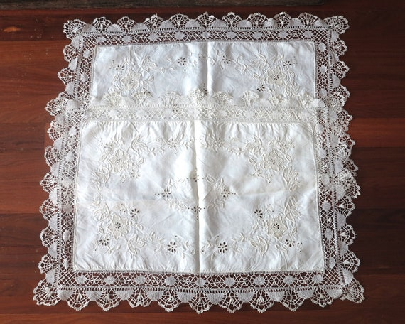 2 embroidered table or tray covers, floral pattern with wide lace border, off-white, 31 x 22 ins / 79 x 56cm, circa mid 20th century