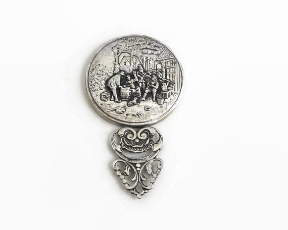 Vintage embossed pewter hand mirror with rural party scene, made in Holland, bevelled mirror, circa 1970s