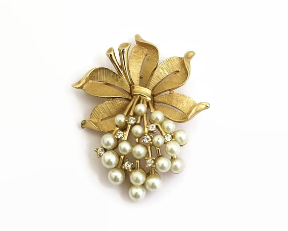 Vintage Crown Trifari pearl and crystal brooch, top textured leaves with pearl and crystal bouquet cascading below, 1960s