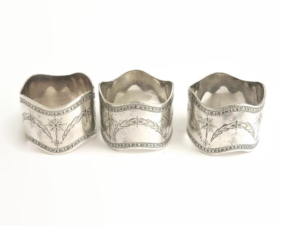 3 antique silver plated napkin rings, engraved pattern of swags and dangling stars, scalloped edges, Edwardian, circa 1900