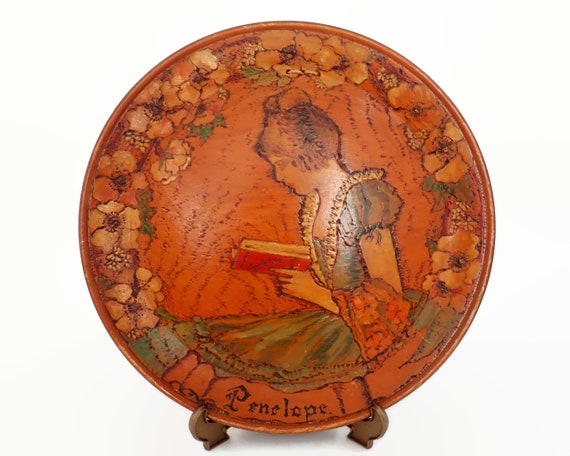 """Poker work wall plate, hand made, portrait of """"Penelope"""" reading, circa 1930s"""