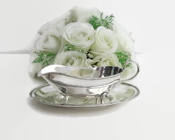 Vintage silver plated gravy boat with matching drip tray, elegant, decorative trim, Silcraft, Australia, mid 20th century