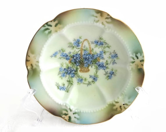 Antique hand painted trinket dish, basket of blue flowers, gilt edge, beaded outline, stencilled pattern on lip, Victorian