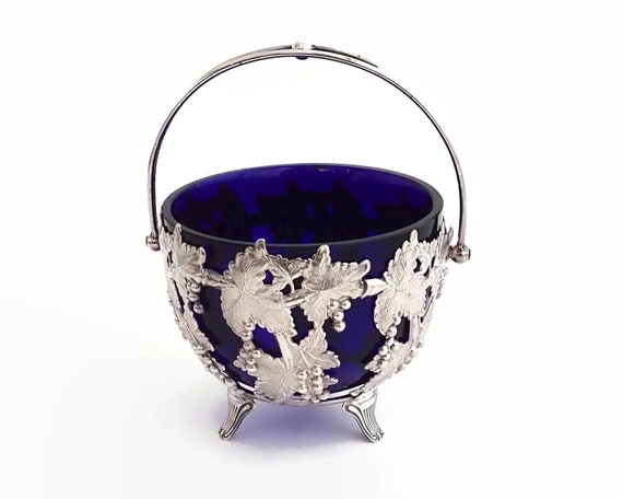 Silver plated bowl with cobalt blue glass insert, open metal work in pattern of leaves and grapes, made in England, mid century