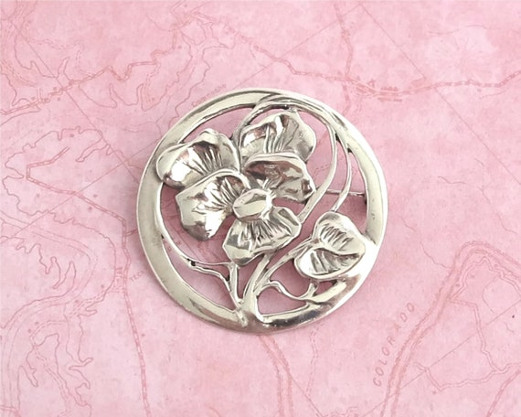 Sterling silver embossed flower brooch, 1.6 inches / 4.25cm across, stamped 925