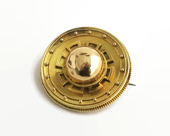 Antique 9 carat gold circular brooch, large Victorian brooch with raised dome center and hidden photo compartment, 10.6 grams, circa 1890