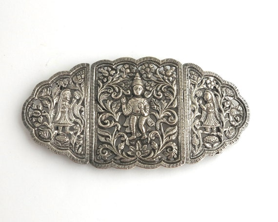 Antique Indian silver buckle with embossed pattern of vines and figures in relief, very elaborate, large, heavy, 93 grams, circa 1900