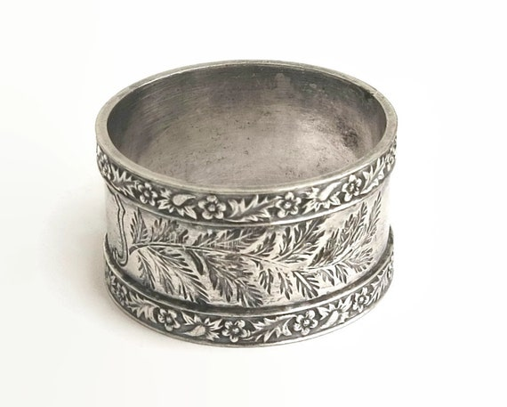 Antique silver plated napkin ring, engraved foliate pattern with floral borders on edges, Stokes and Son, Australia, circa 1910
