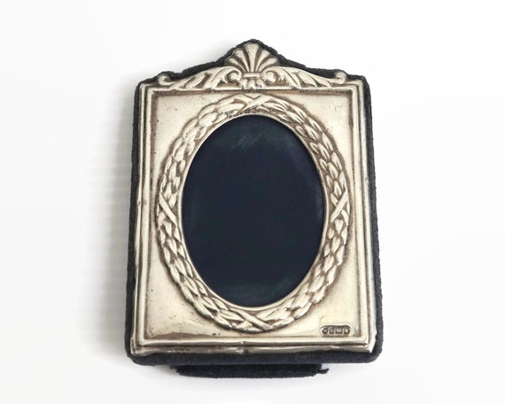 Small sterling silver photo frame, oval opening with fancy border, made in Sheffield, England, 1994
