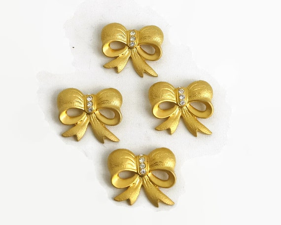 4 vintage gold metal bow buttons with crystals, 3cm x 3.5cm, 1980s, never used